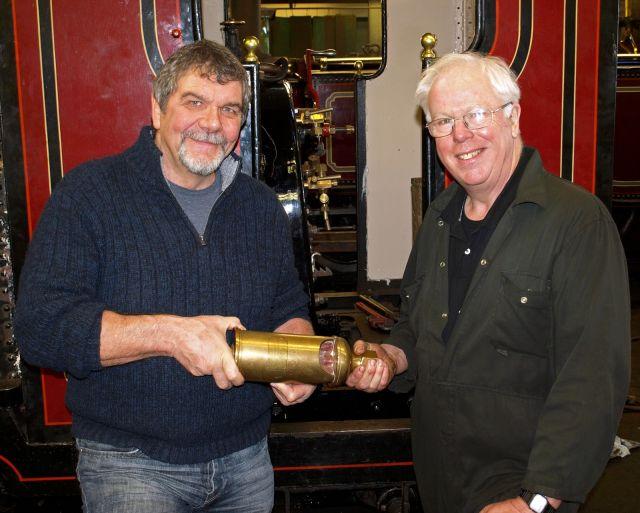 Bill Hoole's grandson, Bill Poacher, presents the whistle to Richard Hanlon at Boston Lodge.