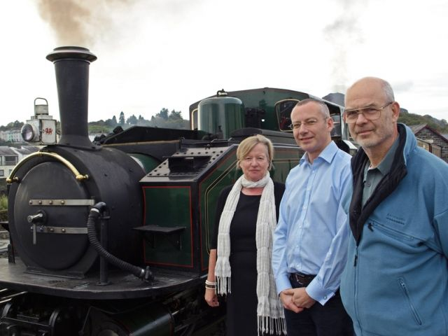 F&WHR Volunteer Coordinator Trica Doyle, Network Rail Route Managing Director for Wales Mark Langman and Andy Savage, Executive Director of the Railway Heritage Trust alonside Ffestiniog Railway Double Fairlie Earl of Merioneth.