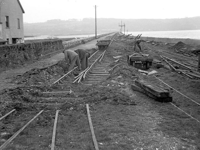 Volunteers attend to track maintenance at Harbour Station in 1955