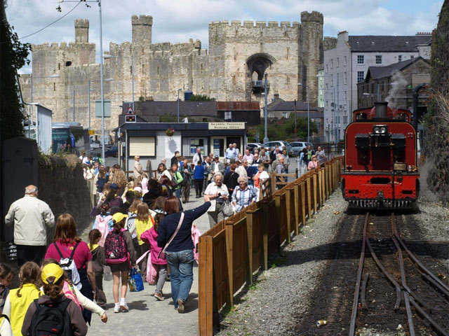 Passengers arrive at Caernarfon Station